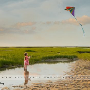 Little girl with a kite at Paines Creek on Cape Cod