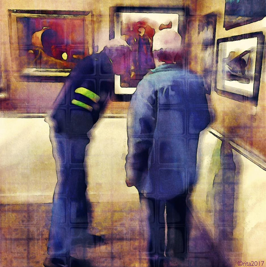 Two men looking at art exhibition